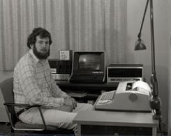 Image Michael Holley's Home Computer in 1978. The items in the photo are a Southwest Technical Products 6800 computer with 36k of memory, dual mini floppies, a Hazeltine 1500 video terminal, and a Trendata1000 Selectric printing terminal. The small box on the disk drive is a homebrew 300 baud modem.  This photograph appeared on the front page of the July 1978 issue of the Northwest Computer Club News.