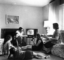Family watching television, c. 1958 By Evert F. Baumgardner [Public domain], via Wikimedia Commons