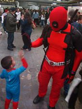 Lil' Spidey high-fiving Deadpool, Big Apple Con, Saturday October 17, 2009. New York City.